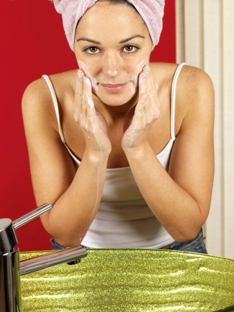 Young Woman Washing Face photo