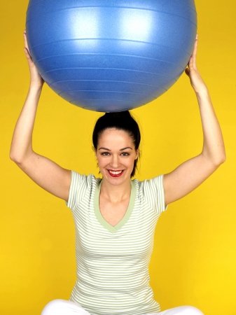 silliness: Young Woman Holding Swiss Fitness Ball