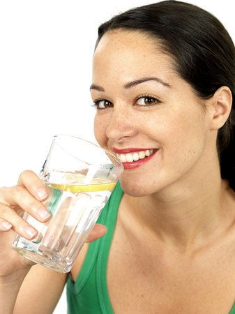 lemon water: Young Woman Drinking a Glass of Water