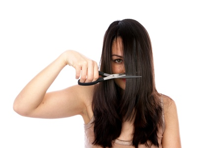 fringes: Young Woman Cutting Hair Stock Photo