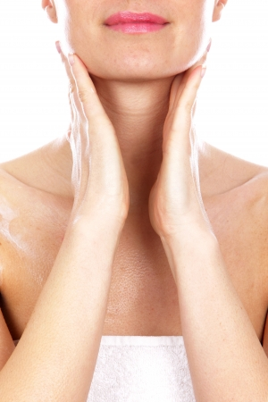 Young Woman Applying Body Cream Stock Photo