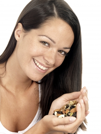 Young Woman Holding Mixed Fruit and Nuts