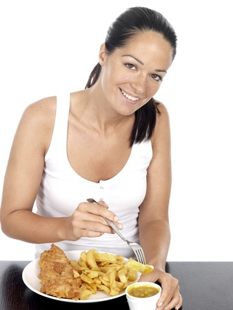 Young Woman Eating Fish and Chips Standard-Bild
