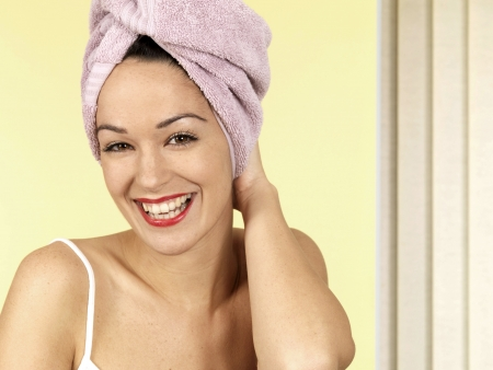 30 something women: Young Woman with Towel on Head Stock Photo