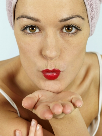 Young Woman Blowing Kiss photo