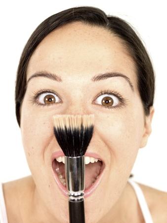 blusher: Young Woman Applying Blusher
