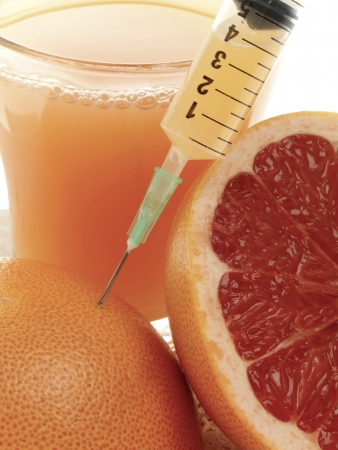 Injecting a Pink Grapefruit photo