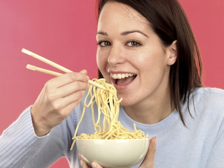 eating noodles: Young Woman Eating Noodles