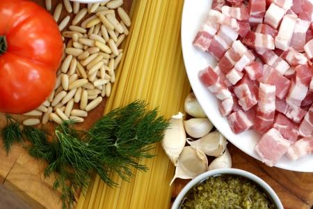 cubed: Pork Lardens with Pasta Stock Photo