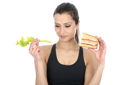 tripple: Model Released  Woman Holding Cake and Celery