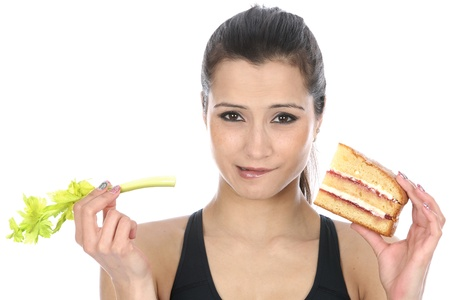 layer cake: Model Released  Woman Holding Cake and Celery