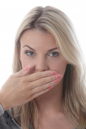 hands in mouth: Model Released.  Young Woman Covering Her Mouth