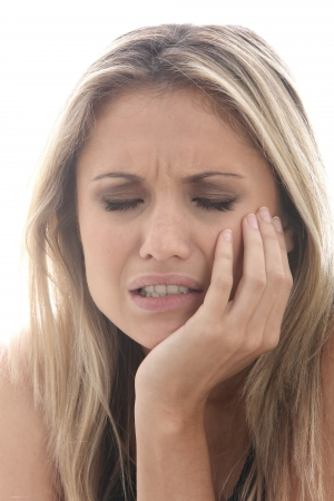 ulcers: Model Released. Young Woman with Toothache Stock Photo