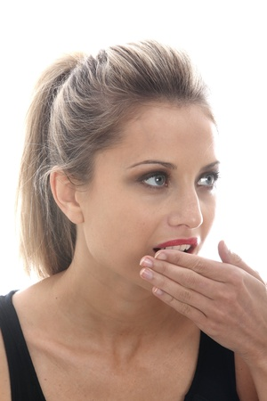 is embarrassed: Model Released. Embarrassed Young Woman Covering Mouth Stock Photo