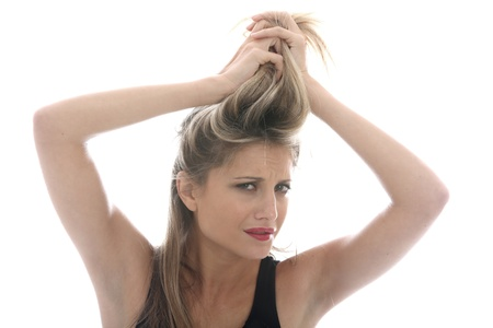 fedup: Model Released. Young Woman Styling Hair Stock Photo