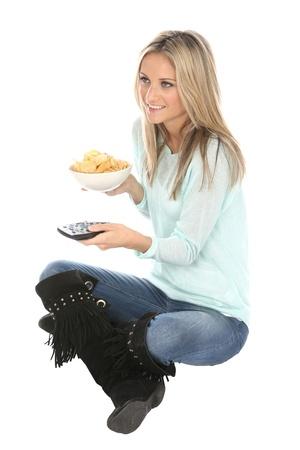 tele: Woman Eating Potato Crisps Stock Photo