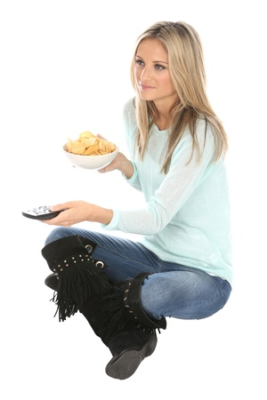 crisps: Woman Eating Potato Crisps Stock Photo