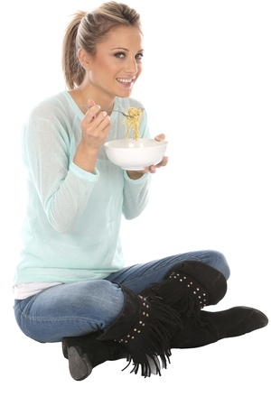 crossed legs: Woman Eating Pot Noodles