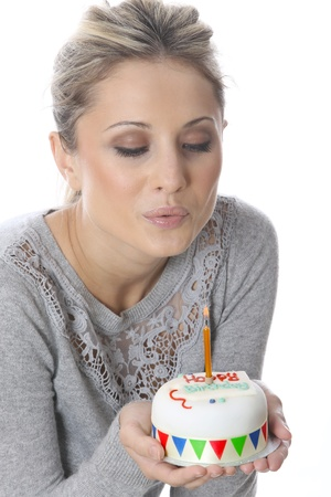 Young Woman Holding Birthday Cake photo