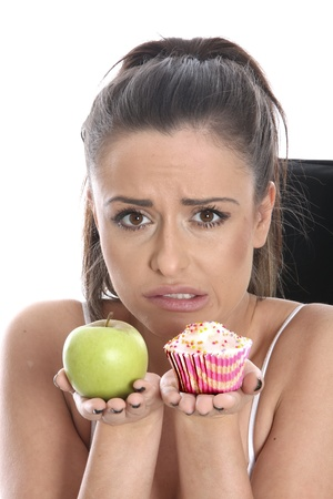 Young Woman Comparing Fruit and Cake