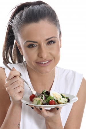 Young Woman Eating Salad  photo
