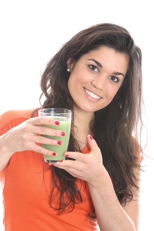 Young Woman Drinking Apple and Asparagus Juice photo