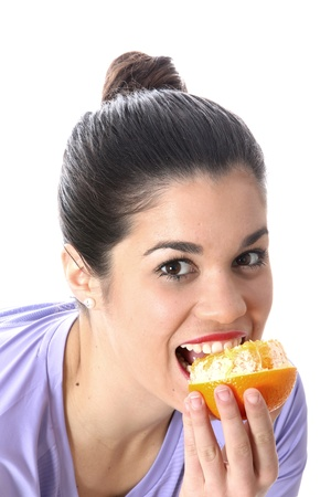 Young Woman Eating an Orange Stock Photo - 21005011