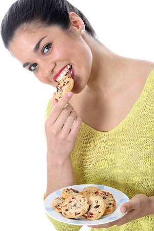 Model Released  Young Woman Eating Chocolate Chip Cookies photo