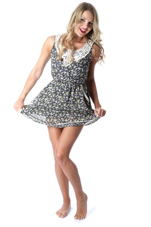 Model Released. Happy Young Woman Short Mini Dress Stock Photo