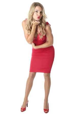 bend over: Model Released. Sexy Young Woman Wearing a Red Dress Stock Photo