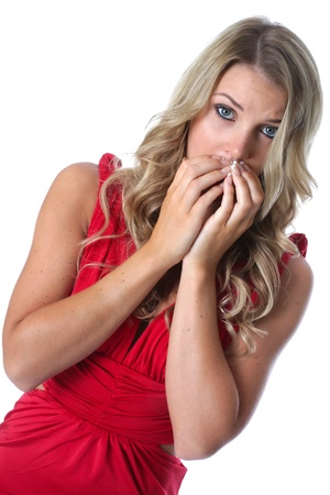 Model Released. Sexy Shocked Young Woman Wearing a Red Dress photo