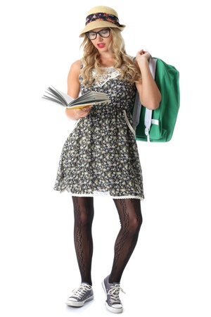 geeky: Model Released. Young Woman Reading Stock Photo