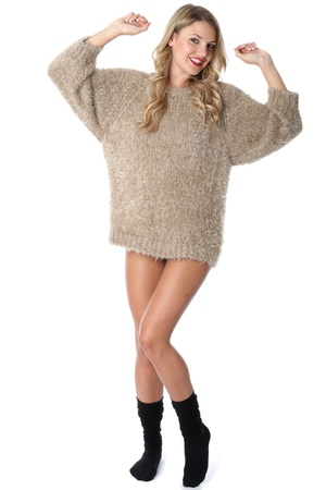 sexy sweater: Model Released. Sexy Young Woman Wearing a Jumper and Socks Stock Photo