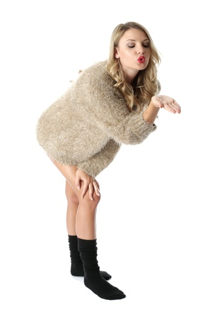 Model Released. Sexy Young Woman Wearing a Jumper and Socks Stock Photo - 21257182