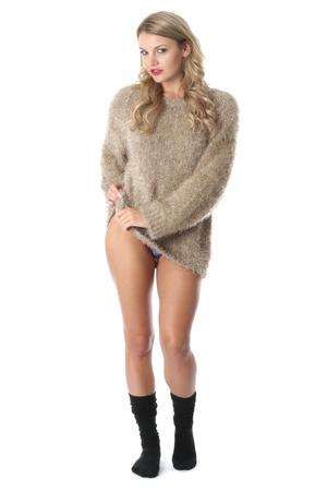 Model Released. Sexy Young Woman Wearing a Jumper and Socks photo