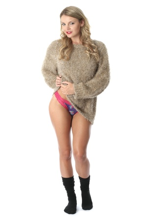 Model Released. Sexy Young Woman Wearing a Jumper and Socks Stock Photo - 21257185