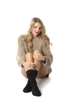 Model Released. Sexy Young Woman Wearing a Jumper and Socks Stock Photo - 21257187