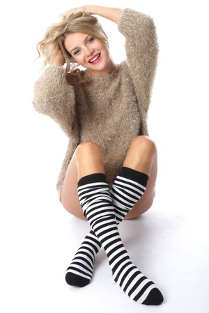 Model Released. Sexy Young Woman Wearing a Jumper and Knee Socks photo
