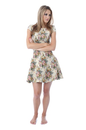 miserable: Model Released. Miserable Young Woman with Folded Arms Stock Photo