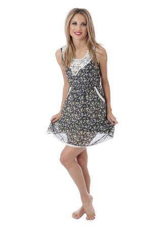 hem: Model Released. Happy Young Woman Wearing a Mini Dress