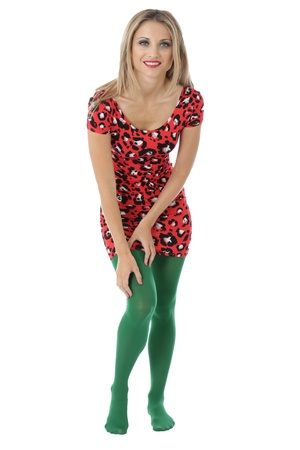 tight fitting: Model Released. Happy Young Woman Wearing a Mini Dress and Green Tights