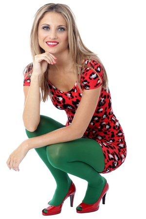 tight fitting: Model Released. Happy Young Woman Squatting Down Stock Photo
