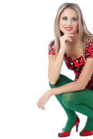 squatting down: Model Released. Happy Young Woman Squatting Down Stock Photo