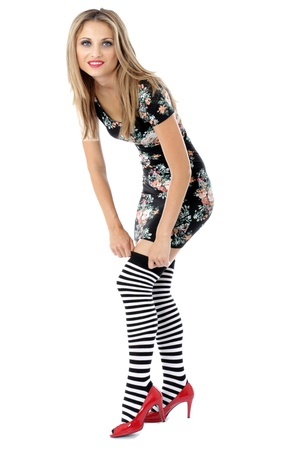pull over: Model Released. Young Woman Adjusting Knee Socks