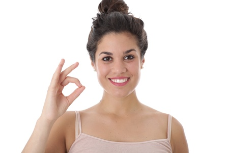 Model Released. Attractive Young Woman Making OK Sign  Stock Photo - 21482435