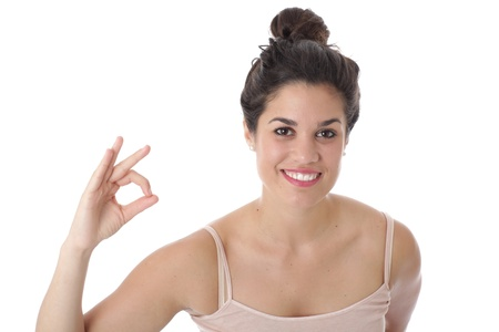 Model Released. Attractive Young Woman Making OK Sign Stock Photo - 21482437