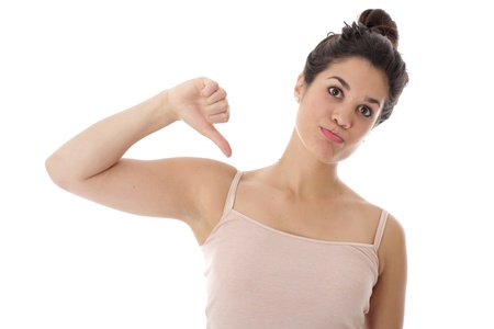 Model Released. Unhappy Young Woman Thumbs Down Stock Photo - 21482443