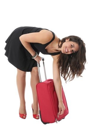 bending forward: Model Released. Attractive Young Woman Doing Up a Suitcase