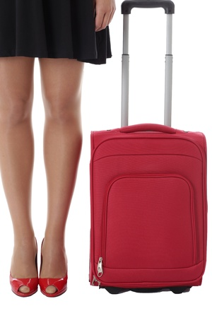 Model Released. Young Woman Standing Next to a Red Suitcase photo