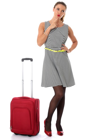Model Released. Young Woman Carrying a Red Suitcase photo